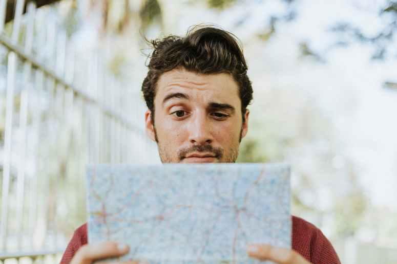 man holding white paper