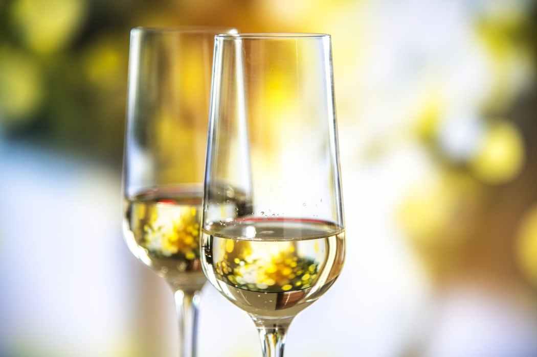 beige liquid in clear glass wine flutes