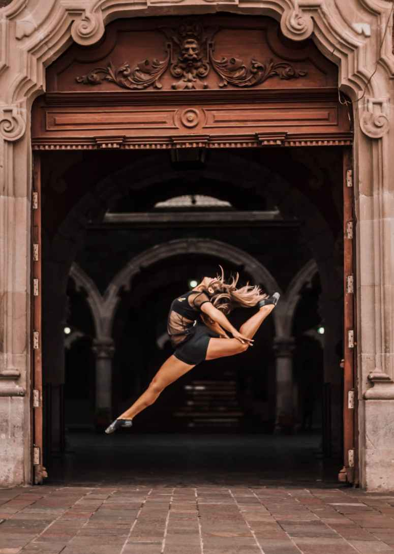 photo of woman doing a ballet dance