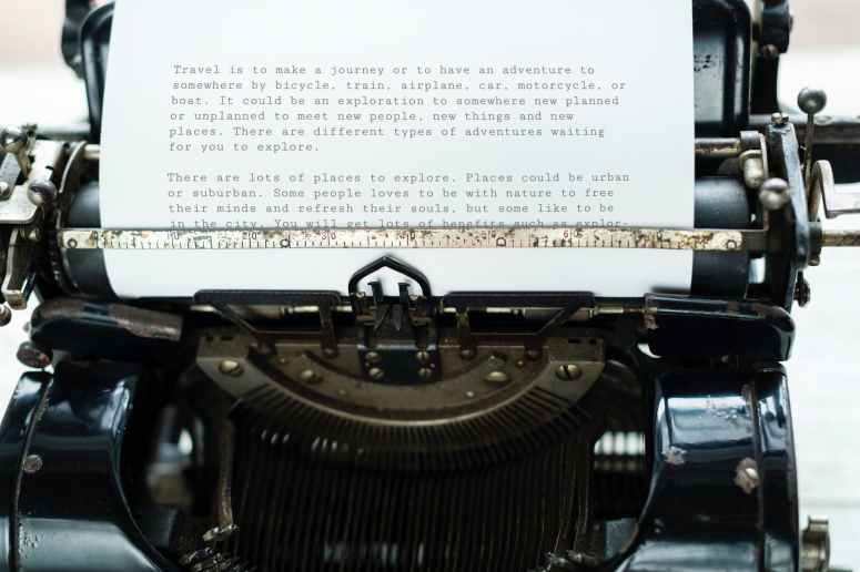 paper attached to typewriter